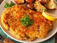 Рецепта Пилешки шницели на фурна с пикантни картофи